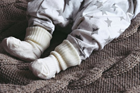 Newborn baby feet in socks