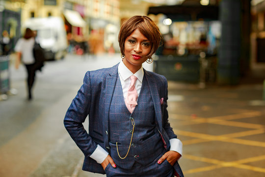 a portrait of a young woman dressed in a tweed suit