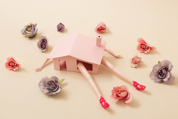 Stay home stay safe concept during spring. Shelter in place restrictions to prevent coronavirus strain (SARS-CoV-2) fast spreading. Pink house with girl doll and spring flowers. Pandemic scenario. Fototapete