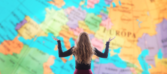 woman from behind looking at map, tourism and travel