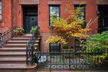 a brownstone building in a historic neighborhood of New York City
