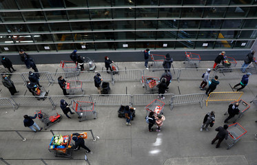 Shoppers practice social distancing as they wait to enter Target store during the outbreak of coronavirus disease (COVID-19) in New York
