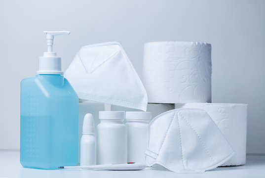 Hand sanitizer and face masks on store shelf hospital supplies for corona virus
