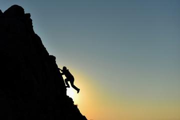 rock climbing striker and climber climbing without equipment