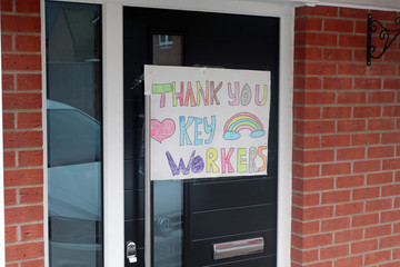 Child's thank you and rainbow painting on door for Coronavirus