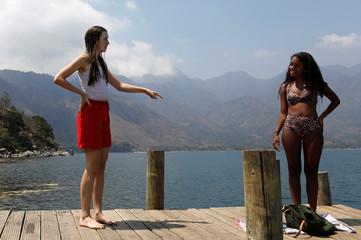 Backpacker and Spanish language student Daehler talks with her friend following the outbreak of coronavirus disease (COVID-19) in San Pedro La Laguna