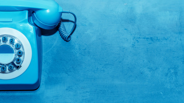 Retro blue telephone close up