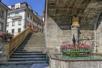 Fountain of Saint-Laurent collegiate church in Estavayer-le-lac by day, Fribourg, Switzerland