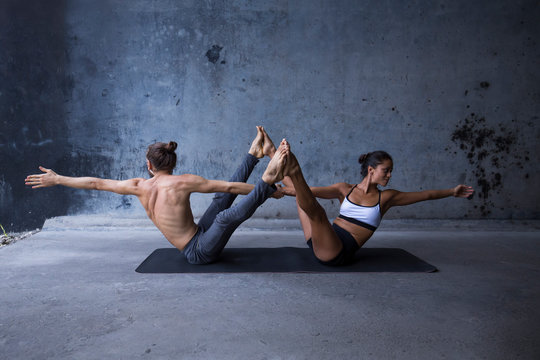 Latin couple practice acroyoga together. Concept of trust and support.