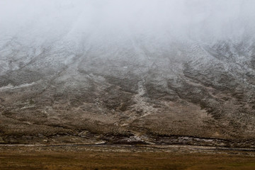 foggy mountain in Iceland. Mountain cover by snow.  Fototapete