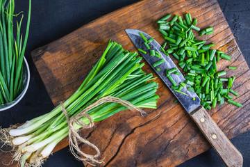 Fototapeta .Fresh onion cut on wooden chopping board obraz