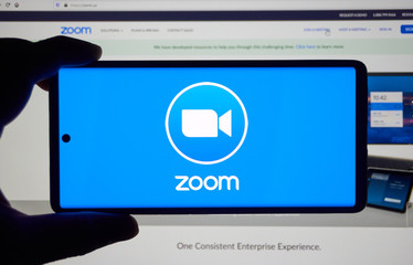 Zoom Communications app and logo on screen.