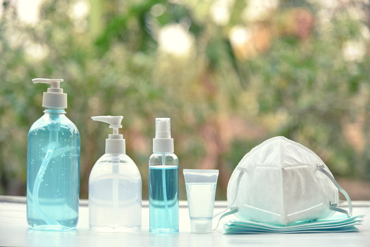 hand sanitizer gel alcohol and medical masks. concept Coronavirus pandemic prevention or covid-19