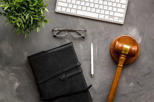 Judge gavel neart documents and keyboard - desk of contemporary lawyer - on grey background top-down