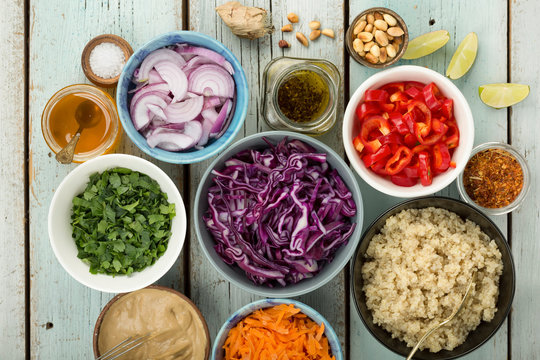 Ingredients for cooking Thai quinoa salad with ginger peanut butter dressing.