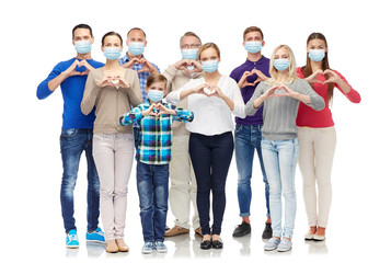 health, quarantine and pandemic concept - group of people wearing protective medical masks for...