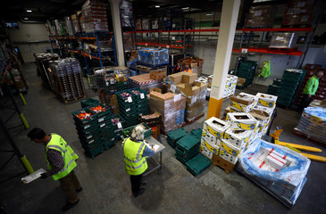 Volunteers sort and check food quality at the FareShare food redistribution centre in Deptford, as the spread of the coronavirus disease (COVID-19) continues, in south east London