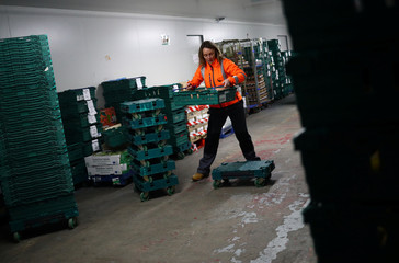 FareShare Development Manager Rachel Ledwith sorts food and checks quality at the FareShare food redistribution centre in Deptford, as the spread of the coronavirus disease (COVID-19) continues, in south east London