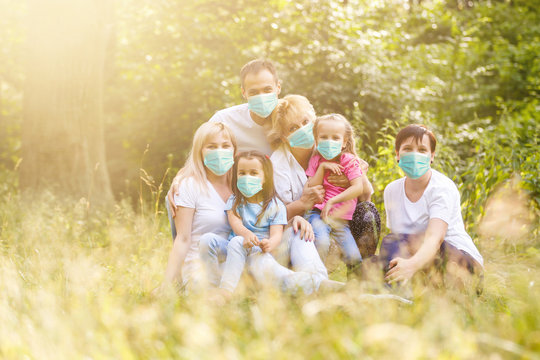 family in protective mask, medical mask to prevent air pollution, fine dust, smog, illness from dust allergy