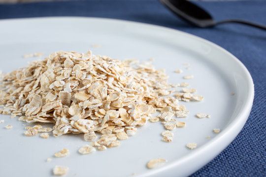 A view of a plate of steel cut oats on a white plate.