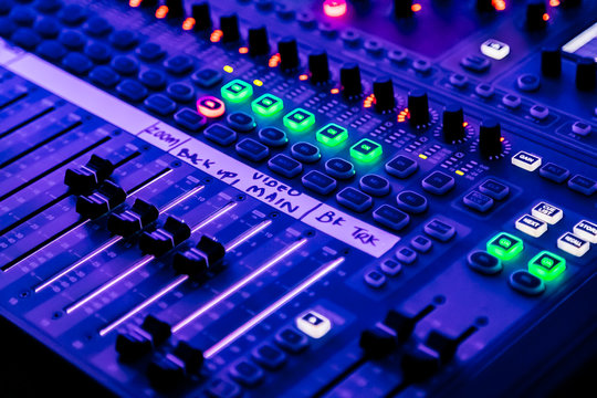 sliders and button on Audio Mixing Desk at live event