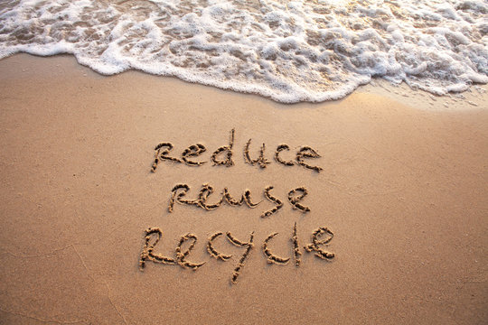 reduce reuse recycle concept drawn on sand, sustainability