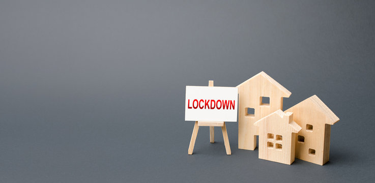 Figures of houses and an easel with the word Lockdown. Tough measures to stop new infections of coronavirus COVID-19 exponential growth. Self isolation and protecting vulnerable people. Restrictions