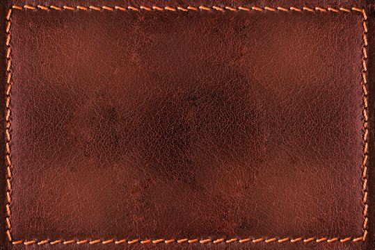 Red leather background with seams