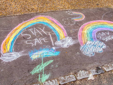 Stay Safe Chalk Drawing Words and Rainbow on Pavement