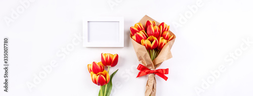 Mother's Day Design Concept, Tulip flower bunch, - Beautiful Red, yellow bouquet isolated on bright white background table, top view, flat lay, copy space