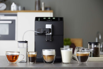Automatic coffee machine and drinks in glass cups in the kitchen Fotomurales