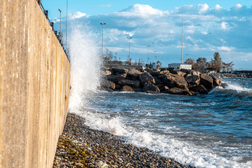 Huge waves crashing over seawall at daytime in Istanbul