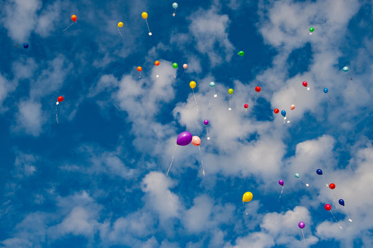 Colorful ballons flying into the air