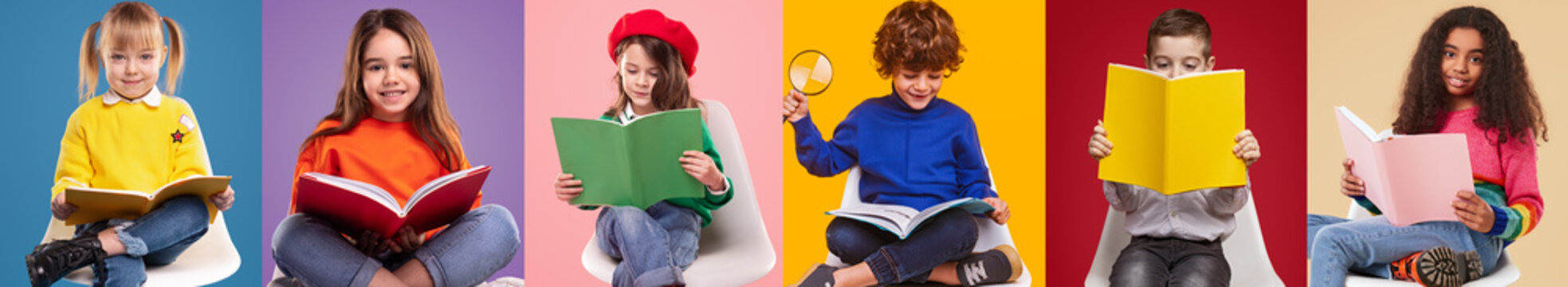 Happy pupils reading colorful books