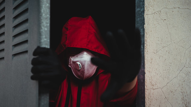 Money Heist character is dressed in new clothes, protected by the new covid19 virus, mask and gloves