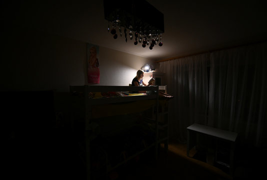 Evgenia Pivovarova reads a book during self-isolation at home in the southern city of Rostov-on-Don