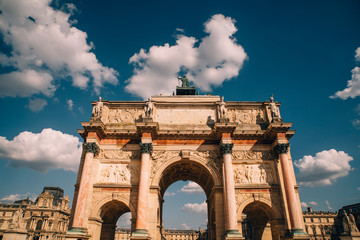 Arch de Triomphe against blue sky in summer sunlight in Paris, France