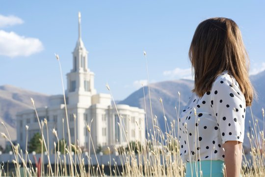 Girl looking towards temple