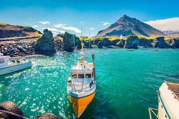 Stunning morning view of small fishing village at the foot of Mt. Stapafell - Arnarstapi or Stapi. Spectacular summer scene of Icelandic countryside. Traveling concept background.