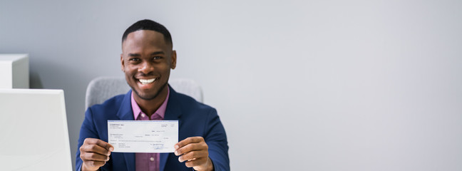 Businessman Holding Cheque
