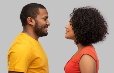 love, relationships and valentines day concept - happy african american couple over grey background Fototapete