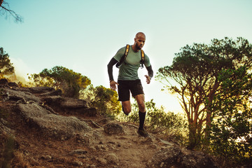 Man running on a rocky mountain trail
