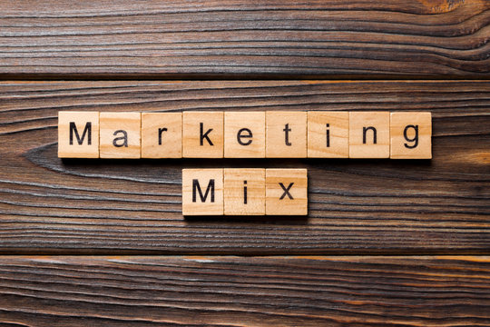 MARKETING MIX word written on wood block. MARKETING MIX text on wooden table for your desing, concept