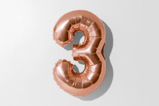 Number 3, Rose gold foil balloon number three isolated on a white background with Clipping Path