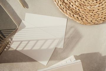 Blank paper sheet, decorations on beige background. Office desk workspace. Business, work template....