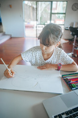 young caucasian girl drawing at home, on-line art calss, home schooling, stay home education