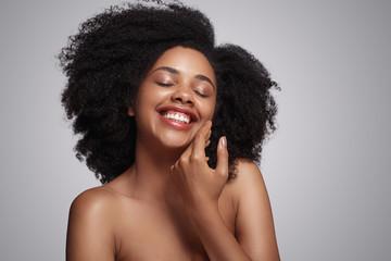 Happy black lady touching soft skin