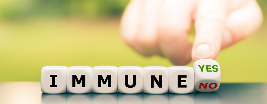 """Corona immune? Hand turns dice and changes the expression """"immune no"""" to """"immune yes""""."""