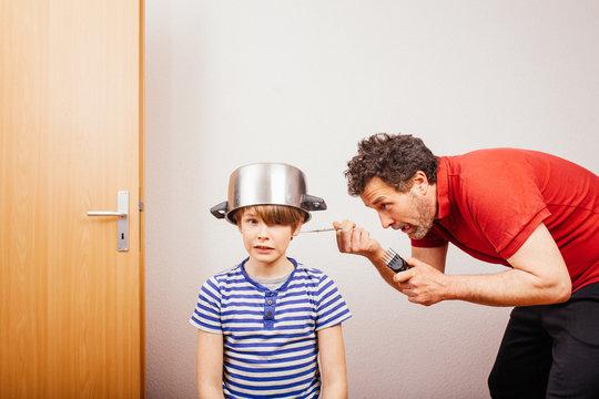 Parent cutting hair at home during 2020 pandemic crisis