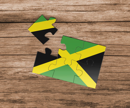 Jamaica national flag on jigsaw puzzle. One piece is missing. Danger concept.